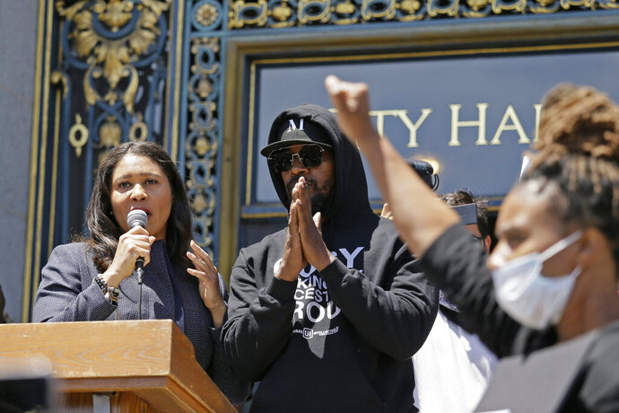 Jamie Foxx and Mayor London Breed take part in a