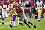 LSU quarterback Joe Burrow (9) is hit by Alabama linebacker Terrell Lewis (24) in the first half of an NCAA college football game Saturday, Nov. 9, 2019, in Tuscaloosa , Ala. (AP Photo/Vasha Hunt)