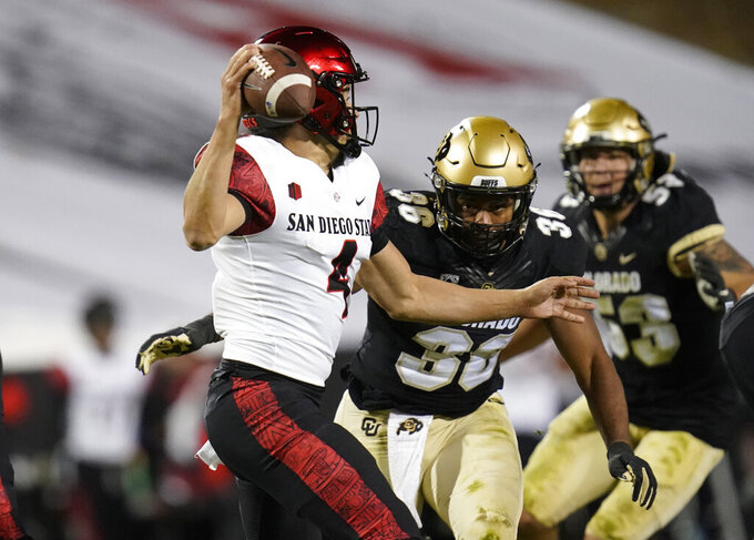 San Diego State quarterback Jordon Brookshire drops back to pass under pressure from Colorado linebacker Akil Jones during the second half of an NCAA college football game Saturday, Nov. 28, 2020, in Boulder, Colo. (AP Photo/David Zalubowski)