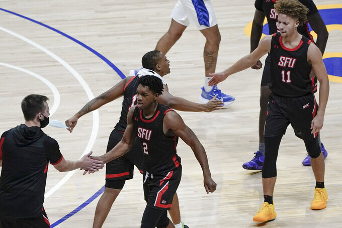 St. Francis' Ramiir Dixon-Conover (2) and Maxwell Land celebrate as they come off the court with a big lead for a timeout during the second half of an NCAA college basketball game against Pittsburgh, Wednesday, Nov. 25, 2020, in Pittsburgh. St. Francis won 80-70. (AP Photo/Keith Srakocic)