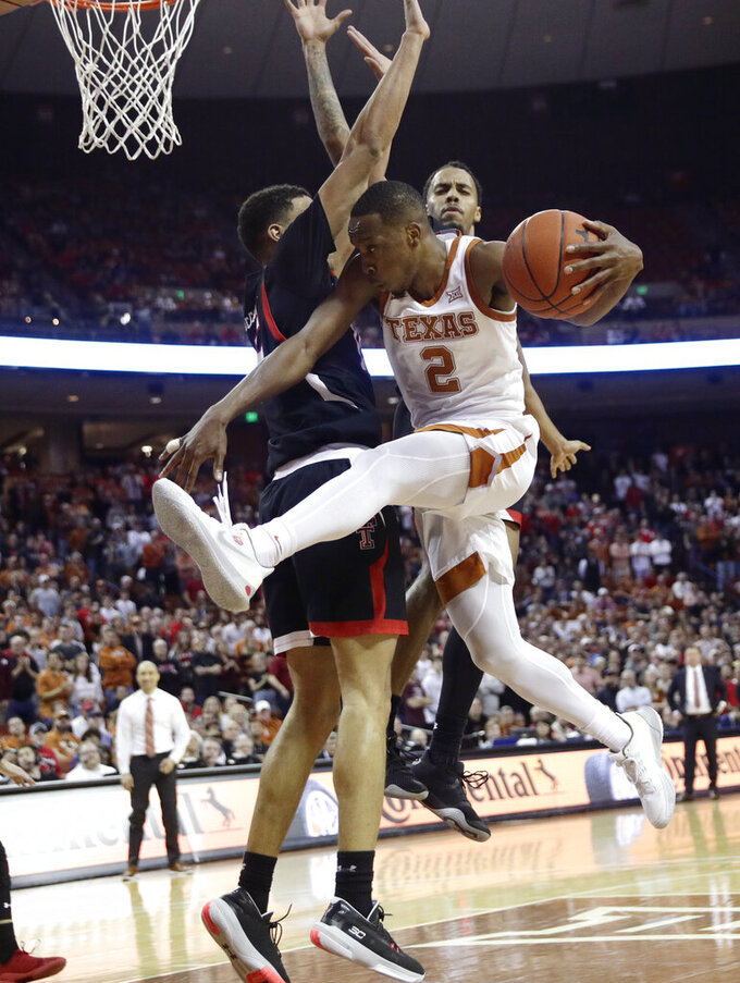 Texas guard Matt Coleman III (2) is blocked by Texas Tech guard Kevin McCullar, left, as he drives to the basket during the second half of an NCAA college basketball game, Saturday, Feb. 8, 2020, in Austin, Texas. Texas Tech won 62-57. (AP Photo/Eric Gay)