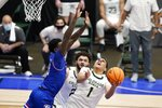 Louisiana Tech guard Amorie Archibald, left, fouls Colorado State guard John Tonje (1) on a shot attempt as David Roddy, rear, looks on in the second half of an NCAA college basketball game in the NIT, Sunday, March 28, 2021, in Frisco, Texas. (AP Photo/Tony Gutierrez)