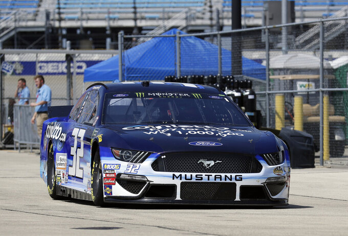 Corey LaJoie drives to the garage during a practice for the NASCAR Sprint Cup Series auto race at Chicagoland Speedway in Joliet, Ill., Saturday, June 29, 2018. (AP Photo/Nam Y. Huh)