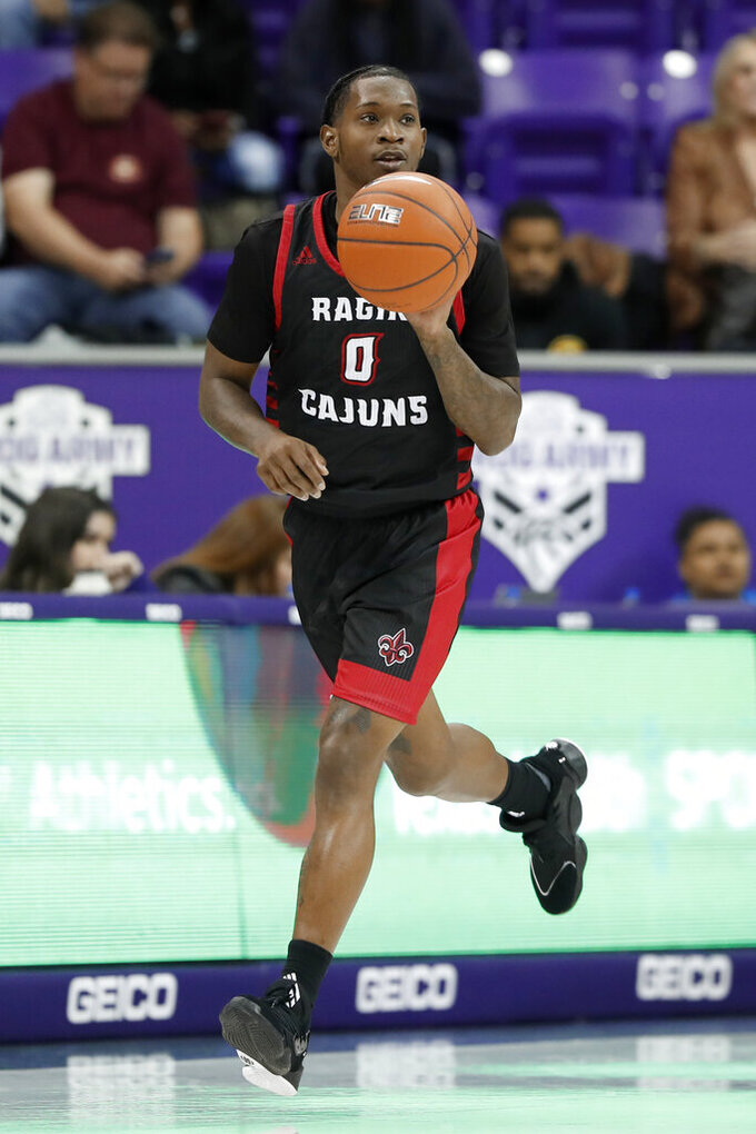 Louisiana-Lafayette guard Cedric Russell brings the ball up against TCU during the first half of an NCAA college basketball game in Fort Worth, Texas, Tuesday, Nov. 12, 2019. (AP Photo/Tony Gutierrez)