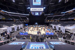 Players and coaches address the media during the first day of the Big Ten NCAA college basketball media days, Thursday, Oct. 7, 2021, in Indianapolis. (AP Photo/Doug McSchooler)