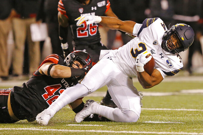 Utah defensive end Mika Tafua (42) tackles California running back Christopher Brown Jr. (34) in the first half of an NCAA college football game Saturday, Oct. 26, 2019, in Salt Lake City. (AP Photo/Rick Bowmer)