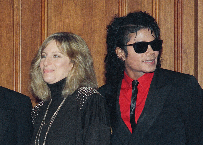 FILE - In this Dec. 14, 1986, file photo, singers Barbra Streisand and Michael Jackson attend the Scopus Awards of the American Friends of the Hebrew University ceremony in Los Angeles. Streisand is apologizing outright for her comments about sexual abuse allegations against Michael Jackson. She said in a second statement Saturday, March 23, 2019, that she should have chosen her words more carefully, and admires the accusers for