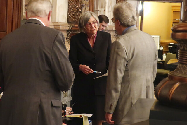 Kansas Senate President Susan Wagle, center, R-Wichita, confers with other Republican lawmakers and staffers during a debate a proposed amendment to the state constitution on abortion, Wednesday, Jan. 29, 2020, at the Statehouse in Topeka, Kan. Wagle backs the proposed amendment, which would overturn a Kansas Supreme Court decision protecting abortion rights. (AP Photo/John Hanna)