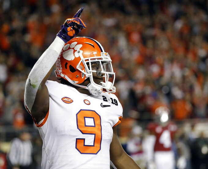 Clemson's Travis Etienne celebrates his touchdown run during the first half the NCAA college football playoff championship game against Alabama, Monday, Jan. 7, 2019, in Santa Clara, Calif. (AP Photo/Chris Carlson)