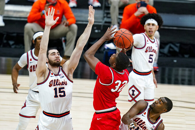 Ohio State forward E.J. Liddell (32) shoots over Illinois forward Giorgi Bezhanishvili (15) in an NCAA college basketball championship game at the Big Ten Conference tournament in Indianapolis, Sunday, March 14, 2021. (AP Photo/Michael Conroy)