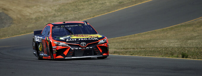Martin Truex Jr. competes during a NASCAR Sprint Cup Series auto race Sunday, June 23, 2019, in Sonoma, Calif. (AP Photo/Ben Margot)