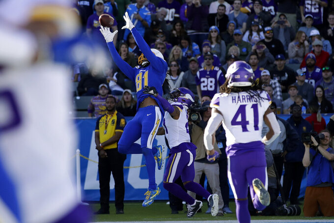 Los Angeles Chargers wide receiver Mike Williams, above, makes a touchdown catch in the end zone as Minnesota Vikings cornerback Mike Hughes defends during the first half of an NFL football game Sunday, Dec. 15, 2019, in Carson, Calif. (AP Photo/Marcio Jose Sanchez)