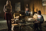 This image released by Warner Bros. Pictures shows Madison Iseman, from left, Katie Sarife and McKenna Grace in a scene from the horror film,