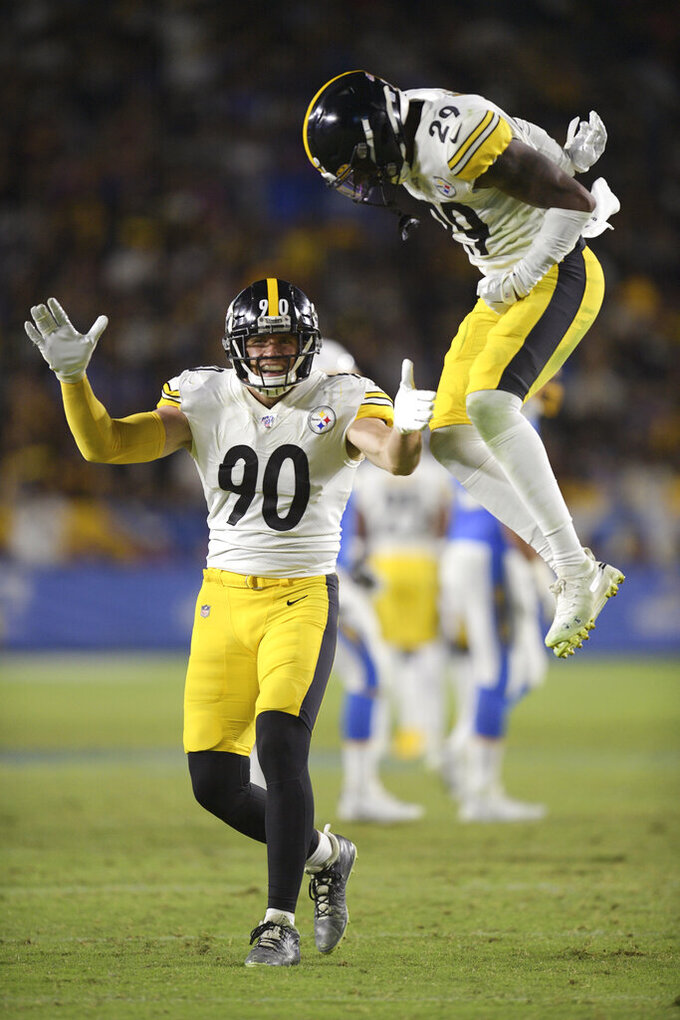 Pittsburgh Steelers outside linebacker T.J. Watt, left, celebrates with defensive back Kam Kelly after blocking a pass during the second half of an NFL football game against the Los Angeles Chargers, Sunday, Oct. 13, 2019, in Carson, Calif. (AP Photo/Kyusung Gong)