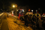 A bus carrying Argentina's Boca Juniors soccer team sits parked outside a police station in Belo Horizonte, Brazil, early Wednesday, July 21, 2021, after the team was eliminated from the Copa Libertadores tournament, which ended in a brawl and destruction in the locker room. (AP Photo/Bruna Prado)