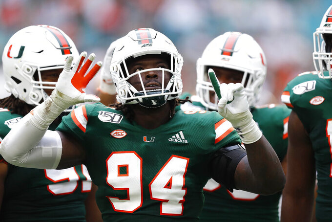Miami defensive lineman Trevon Hill (94) celebrates a sack against Central Michigan quarterback David Moore (2) during the first half of an NCAA college football game, Saturday, Sept. 21, 2019, in Miami Gardens, Fla. (AP Photo/Brynn Anderson)