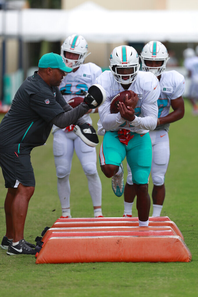 Miami Dolphins running back Kenyan Drake runs drills at the teams NFL football training camp, Thursday, Aug. 1, 2019 in Davie, Fla. (AP Photo/Wilfredo Lee)