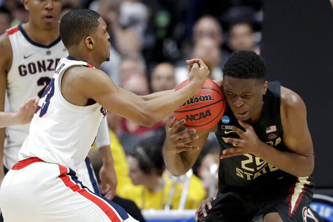 Gonzaga guard Zach Norvell Jr., left, vies for a loose ball with Florida State forward Mfiondu Kabengele during the second half an NCAA men's college basketball tournament West Region semifinal Thursday, March 28, 2019, in Anaheim, Calif. (AP Photo/Marcio Jose Sanchez)