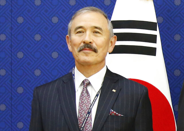 "FILE - In this Nov. 6, 2019, file photo, U.S. Ambassador to Seoul Harry Harris pose for photos during their meeting at the Foreign Ministry in Seoul, South Korea. Harris on Thursday, Jan. 16, 2020, says he was surprised and pleased that North Korea did not give the U.S. an unwelcome ""Christmas gift"" because of stalled nuclear disarmament talks, and that President Donald Trump is still confident it will denuclearize. (Heo Ran/Pool Photo via AP, File)"