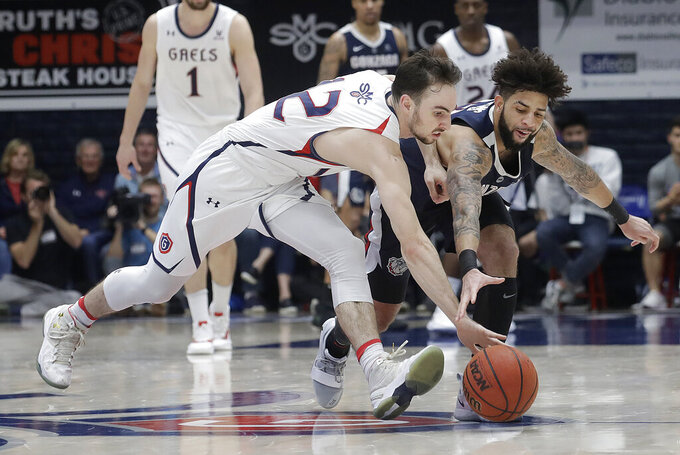 Saint Mary's guard Tommy Kuhse, left, and Gonzaga guard Josh Perkins reach for a loose ball during the second half of an NCAA college basketball game in Moraga, Calif., Saturday, March 2, 2019. (AP Photo/Jeff Chiu)