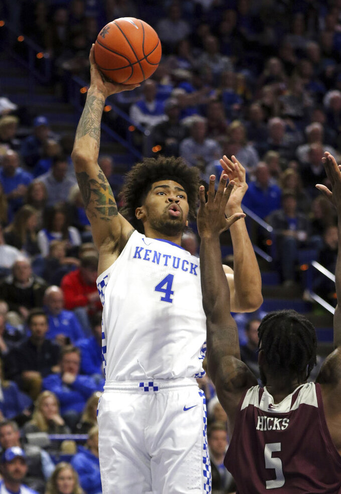 Kentucky's Nick Richards (4) shoots while defended by Eastern Kentucky's Darius Hicks (5) during the second half of an NCAA college basketball game in Lexington, Ky., Friday, Nov. 8, 2019. Kentucky won 91-49. (AP Photo/James Crisp)