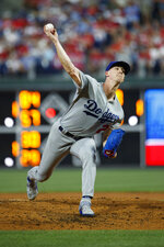 Los Angeles Dodgers' Walker Buehler pitches during the fourth inning of a baseball game against the Philadelphia Phillies, Tuesday, July 16, 2019, in Philadelphia. (AP Photo/Matt Slocum)