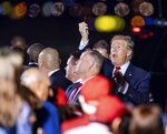 President Donald Trump arrives on Air Force One at Palm Beach International Airport in West Palm Beach, Fla., on Tuesday, Nov. 26, 2019. (Richard Graulich /Palm Beach Post via AP)