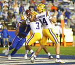 LSU quarterback Max Johnson (14) throws a pass from the end zone during the team's NCAA college football game against Florida on Saturday, Dec. 12, 2020, in Gainesville, Fla. (Brad McClenny/The Gainesville Sun via AP)