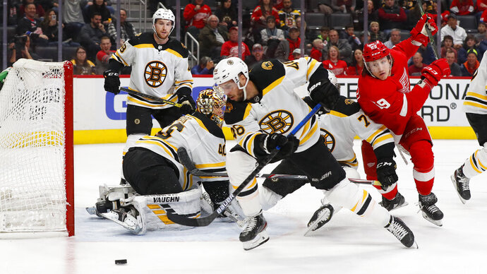 Boston Bruins defenseman Matt Grzelcyk (48) clears the puck in the second period of an NHL hockey game against the Detroit Red Wings, Sunday, Feb. 9, 2020, in Detroit. (AP Photo/Paul Sancya)