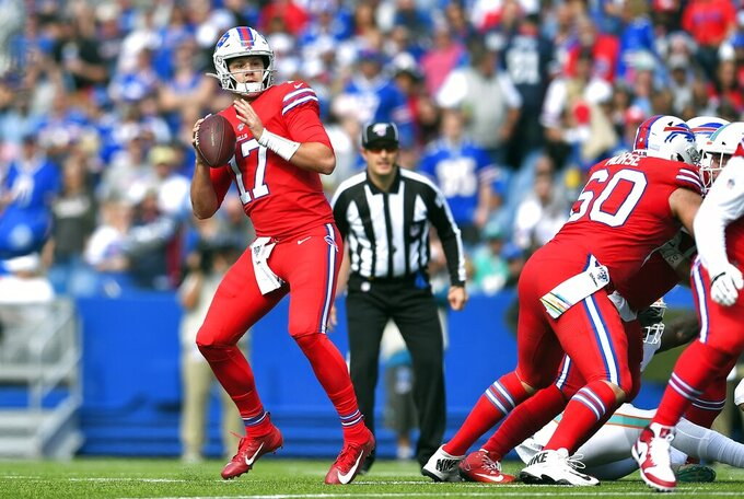 Buffalo Bills quarterback Josh Allen drops back to pass against the Miami Dolphins in the first half of an NFL football game, Sunday, Oct. 20, 2019, in Orchard Park, N.Y. (AP Photo/Adrian Kraus)