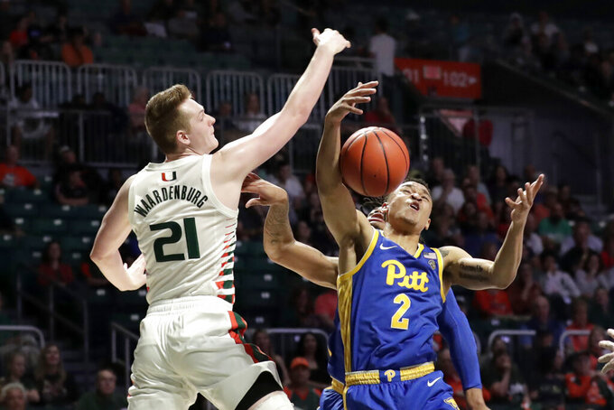 Pittsburgh guard Trey McGowens (2) and Miami forward Sam Waardenburg (21) fight for the ball during the second half of an NCAA college basketball game, Sunday, Jan. 12, 2020, in Coral Gables, Fla. (AP Photo/Lynne Sladky)