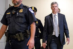 Ambassador William Taylor, Jr. arrives for a closed door meeting to testify as part of the House impeachment inquiry into President Donald Trump on Capitol Hill in Washington, Tuesday, Oct. 22, 2019. (AP Photo/Andrew Harnik)