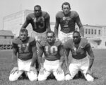 FILE - In this July 31, 1946, file photo, five members of the Los Angeles Rams who also played at the University of California at Los Angeles pose at the Rams' football training camp at Compton, Calif. Front row, from left to right: guard Jack Finlay, guard Nate de Francisco, end Woody Strode. Back row, from left to right: backs Kenny Washington and Bob Waterfield. Washington was considered the best college player in American as a senior, but was not drafted by an NFL team because he was African American. Willis went on to a stellar pro career with the Cleveland Browns and was inducted into the Pro Football Hall of Fame in 1977. (AP Photo/File)