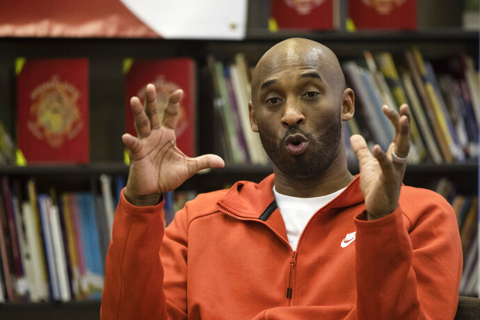 FLE - In this March 21, 2019, file photo, Kobe Bryant speaks with students at Andrew Hamilton School in Philadelphia. Kobe Bryant played on the Redeem Team in 2008, the one that delivered a gold medal in Beijing after a series of USA Basketball disappointments in big tournaments. Back in Beijing this weekend, Bryant isn't sure another Redeem Team will be so easy to find for the U.S. (AP Photo/Matt Rourke, File)