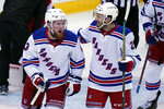 New York Rangers' Alexis Lafrenière, left, celebrates his goal with teammate Anthony Bitetto during the second period of the NHL hockey game against the New Jersey Devils in Newark, N.J., Sunday, April 18, 2021. (AP Photo/Seth Wenig)