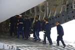 President Donald Trump, right, walks with an official party onto an aircraft carrying a transfer case containing the remains of Scott A. Wirtz, Saturday, Jan. 19, 2019, at Dover Air Force Base, Del. According to the Department of Defense, Wirtz, a civilian and former Navy SEAL from St. Louis, Mo., was killed Jan. 16, 2019, in a suicide bomb attack in Manbij, Syria. (AP Photo/Patrick Semansky)