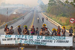 Kayapo Indigenous protesters block highway BR-163 with a banner that reads in Portuguese