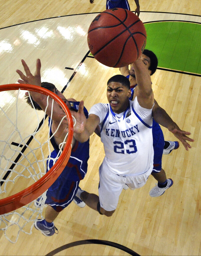 FILE- In this April 2, 2012, file photo, Kentucky forward Anthony Davis (23) drives to the basket in front of Kansas center Jeff Withey, left, and forward Thomas Robinson, behind, during the second half of the NCAA Final Four college basketball tournament championship game in New Orleans. Anthony Davis didn't need to score in big numbers to control a game. He made that point clear during the final performance of his freshman season.Chris Steppig/NCAA Photos, Pool via AP, File)