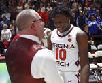 Virginia Tech coach Buzz Williams and Jonathan Kabongo celebrate the team's 77-72 win over Duke in an NCAA college basketball game Tuesday, Feb. Feb. 26, 2019, in Blacksburg, Va. (Matt Gentry/The Roanoke Times via AP)