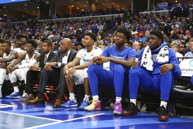 Memphis' James Wiseman, second from right, watches the team's NCAA college basketball game against Arkansas-Little Rock on Wednesday, Nov. 20, 2019, in Memphis, Tenn. (AP Photo/Karen Pulfer Focht)