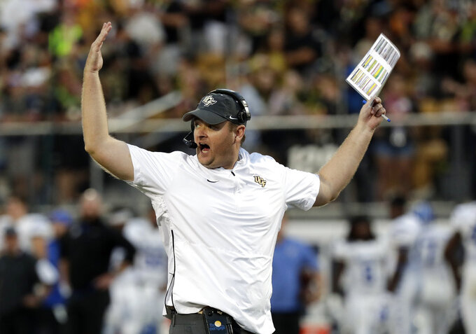 FILE - In this Dec. 1, 2018, file photo, Central Florida head coach Josh Heupel waves his arms during the first half of the American Athletic Conference championship NCAA college football game against Memphis, in Orlando, Fla. No. 7 Central Florida is aiming for a second straight undefeated season and self-proclaimed national championship when they go up against No. 11 LSU in the Fiesta Bowl, Tuesday, Jan. 1, 2019.  (AP Photo/John Raoux, File)
