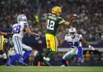Green Bay Packers quarterback Aaron Rodgers (12) throws a pass as Dallas Cowboys defensive end Robert Quinn (58) and Chidobe Awuzie (24) defend in the first half of an NFL football game in Arlington, Texas, Sunday, Oct. 6, 2019. (AP Photo/Ron Jenkins)