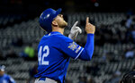 Kansas City Royals' Hunter Dozier points skyward after hitting a home run during the second inning of a baseball game against the Chicago White Sox, Monday, April 15, 2019, in Chicago. (AP Photo/Matt Marton)