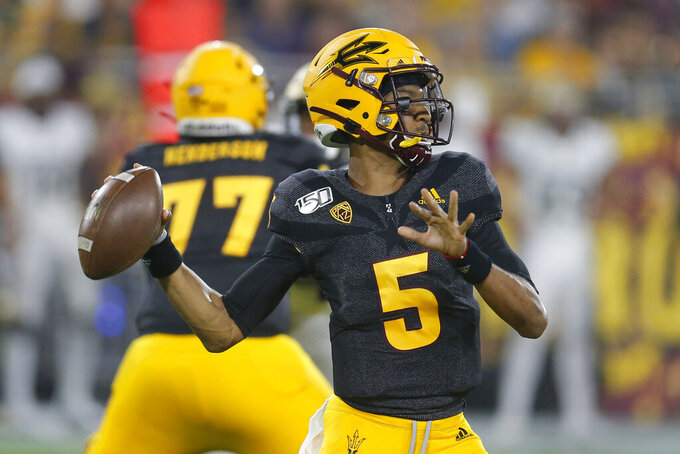 Arizona State quarterback Jayden Daniels throws for a first down against Colorado during the first half of an NCAA college football game Saturday, Sept. 21, 2019, in Tempe, Ariz. (AP Photo/Rick Scuteri)