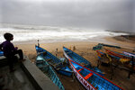 Indians watch as waves crash with shores on the Arabian Sea coast in Veraval, Gujarat, India, Thursday, June 13, 2019. Authorities have evacuated nearly 300,000 people from India's western coastline ahead of a very severe cyclone that's expected to make landfall as the year's second major storm. The India Meteorological Department says Cyclone Vayu, named after the Hindi word for wind, could glance the western state of Gujarat Thursday afternoon before returning to sea. (AP Photo/Ajit Solanki)