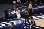 Minnesota Lynx's Napheesa Collier (24) shoots next to Chicago Sky's Candace Parker (3) during the first half of a WNBA basketball game Tuesday, June 15, 2021, in Minneapolis. (AP Photo/Stacy Bengs)
