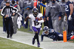 Baltimore Ravens wide receiver Marquise Brown (15) gets past Tennessee Titans cornerback Adoree' Jackson (25) in the second half of an NFL wild-card playoff football game Sunday, Jan. 10, 2021, in Nashville, Tenn. (AP Photo/Wade Payne)