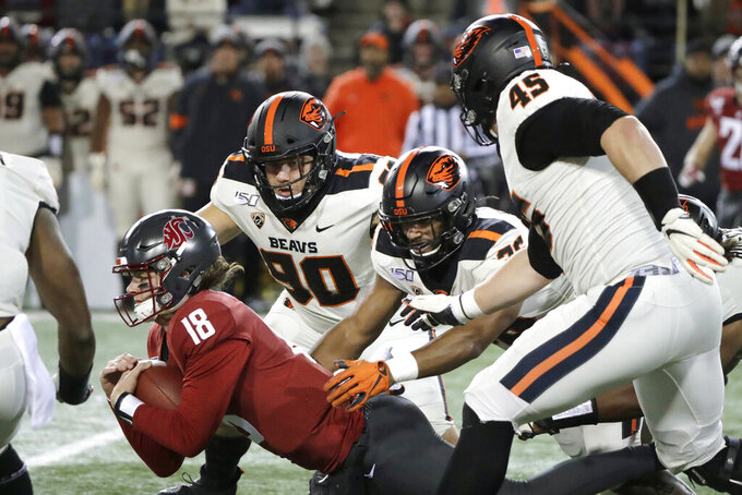 Washington State quarterback Anthony Gordon (18) dives for yardage after he recovered his own fumble during the first half of the team's NCAA college football game against Oregon State, Saturday, Nov. 23, 2019, in Pullman, Wash. (AP Photo/Ted S. Warren)