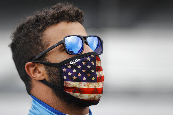 Bubba Wallace checks the sky during a weather delay before a NASCAR Cup Series auto race at Indianapolis Motor Speedway in Indianapolis, Sunday, July 5, 2020. (AP Photo/Darron Cummings)