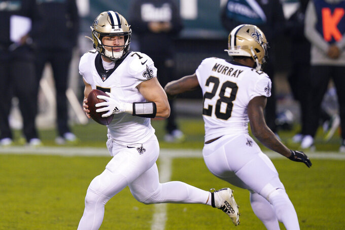 New Orleans Saints' Taysom Hill drops back during the first half of an NFL football game against the Philadelphia Eagles, Sunday, Dec. 13, 2020, in Philadelphia. (AP Photo/Chris Szagola)